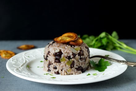 Classic Cuban black beans and rice dish called Moros Y Cristianos in Spanish. A perfect side dish! #cuba #rice | cookingtheglobe.com