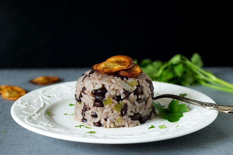 Classic Cuban black beans and rice dish called Moros Y Cristianos in Spanish. A perfect side dish! #cuba #rice   cookingtheglobe.com