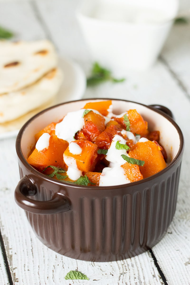 This sweet & savory Afghan pumpkin with yogurt-garlic sauce (Kadu Bouranee or Kadoo Borani) tastes fantastic and it's so easy to make! #Afghan #pumpkin   cookingtheglobe.com
