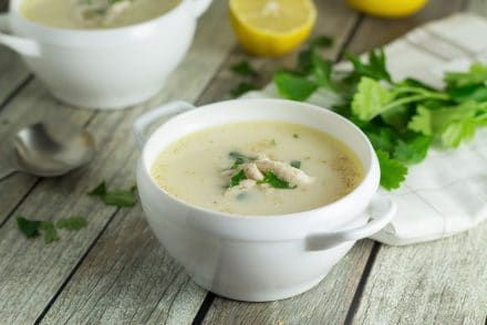 This Greek lemon rice soup, called Avgolemono, is both light and creamy. It will brighten your day! #soup #lemon #chicken | cookingtheglobe.com
