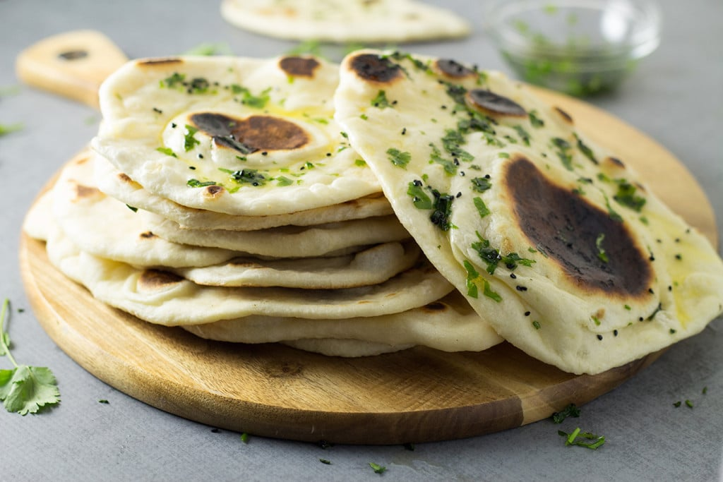 How to make Naan bread at home + authentic Indian recipe #indian #bread   cookingtheglobe.com