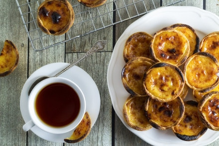 These flaky and creamy Portuguese egg tarts, called Pastel de Nata are melt-in-your-mouth good!   cookingtheglobe.com