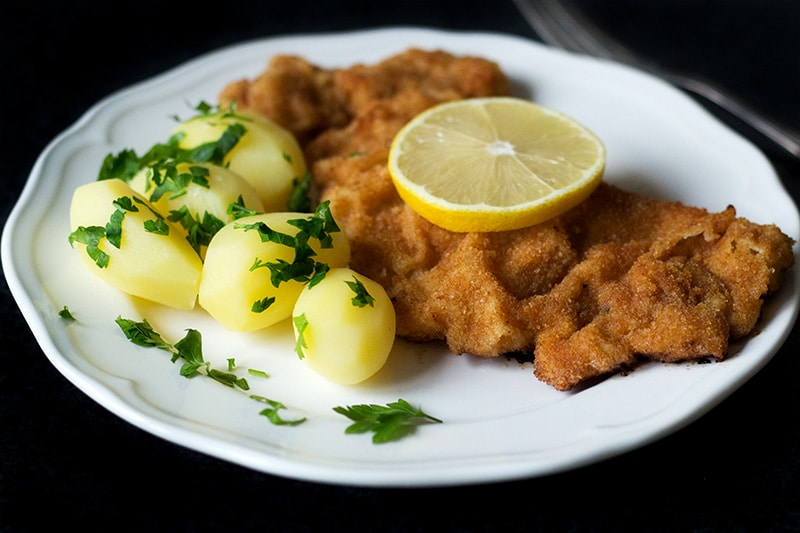Wiener schnitzel is a traditional Austrian dish made from veal cutlets. It's a perfect easy & quick dinner! #austria #veal | cookingtheglobe.com
