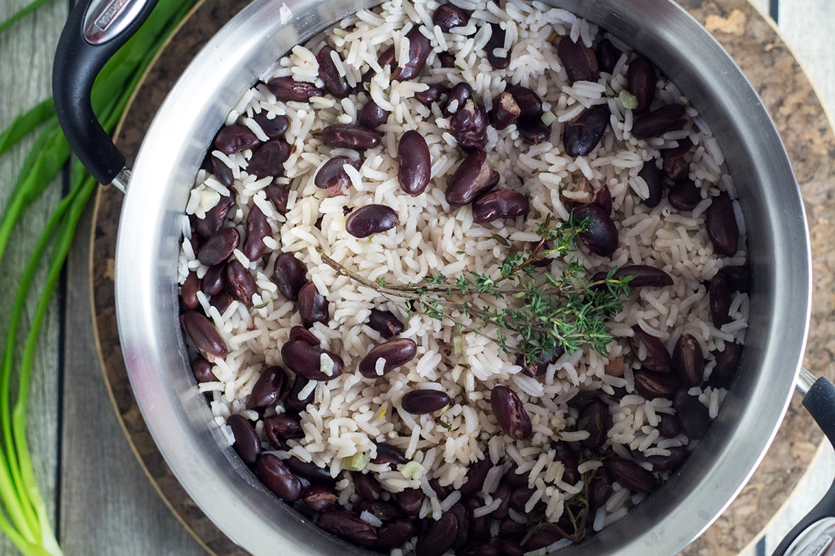 If you haven't tried Jamaican rice and peas yet, then you must be living on the moon. Mildly sweet coconut rice with a kick of the pepper, yum!   cookingtheglobe.com
