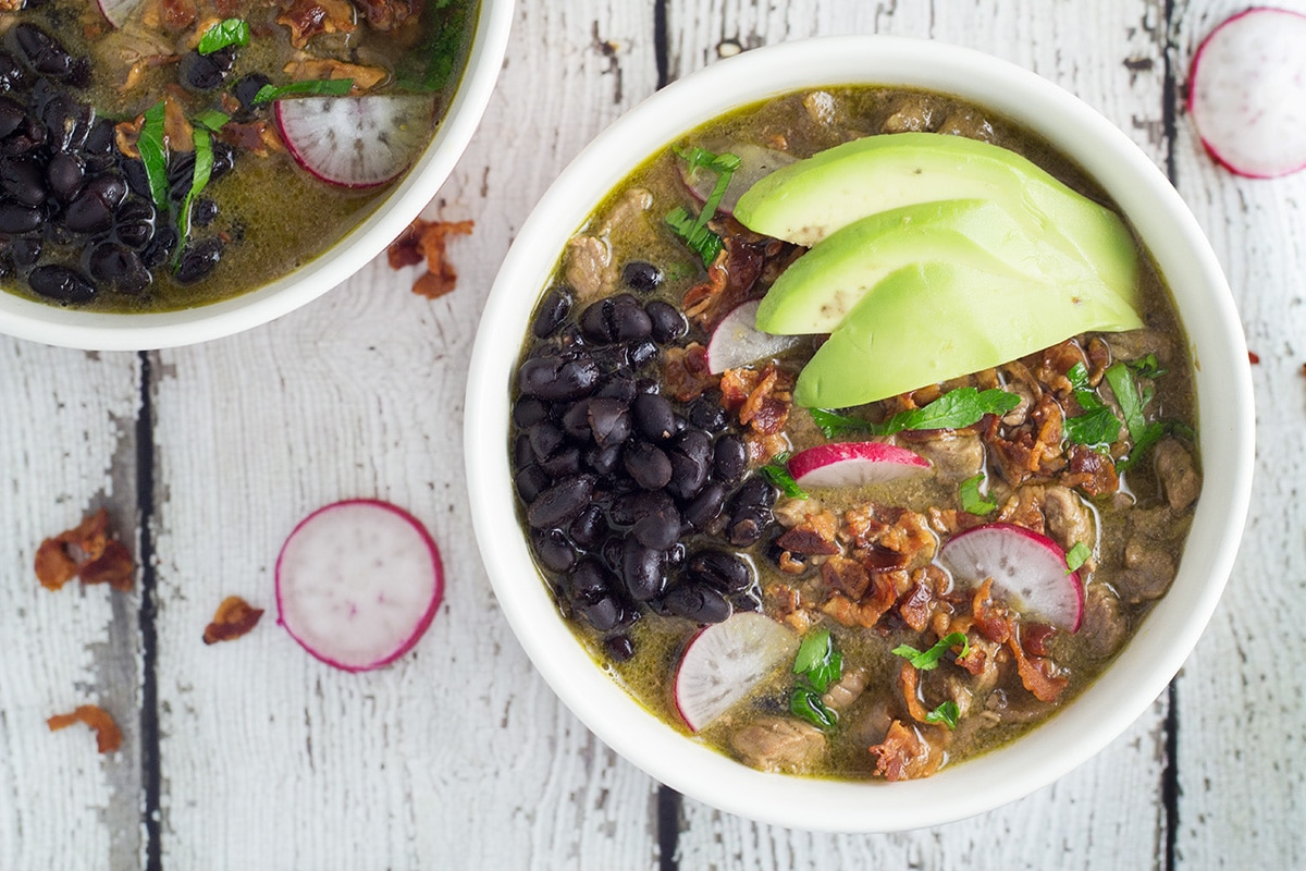 Carne en su Jugo is a flavorful Mexican soup filled with beef, bacon, beans, tomatillos and veggies! | cookingtheglobe.com