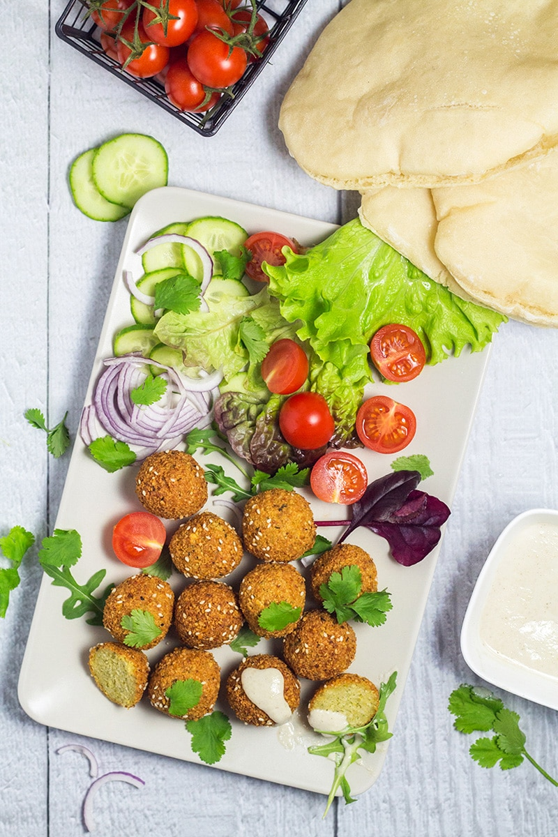 Wondering how to make falafel at home? Check out our comprehensive guide on this Middle Eastern appetizer + the authentic recipe! | cookingtheglobe.com