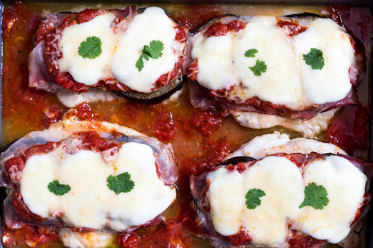 This Chicken Sorrentino includes eggplant, prosciutto, mozzarella, Parmesan cheese and marinara sauce. How is that for a combination? | cookingtheglobe.com