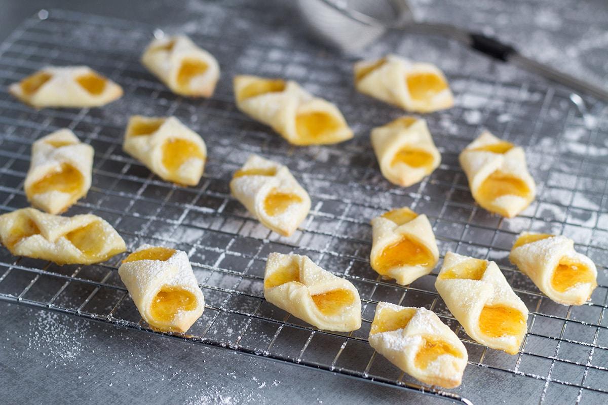 These Polish cream cheese cookies (Kolaczki or Kolacky) will be the best cookies you ever had!   cookingtheglobe.com