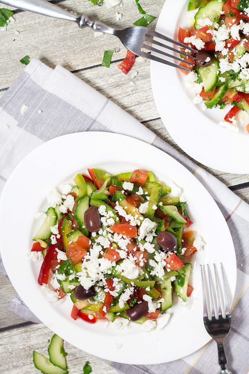 This colorful Bulgarian Shopska Salad is loaded with veggies! Perfect for hot summer days! | cookingtheglobe.com