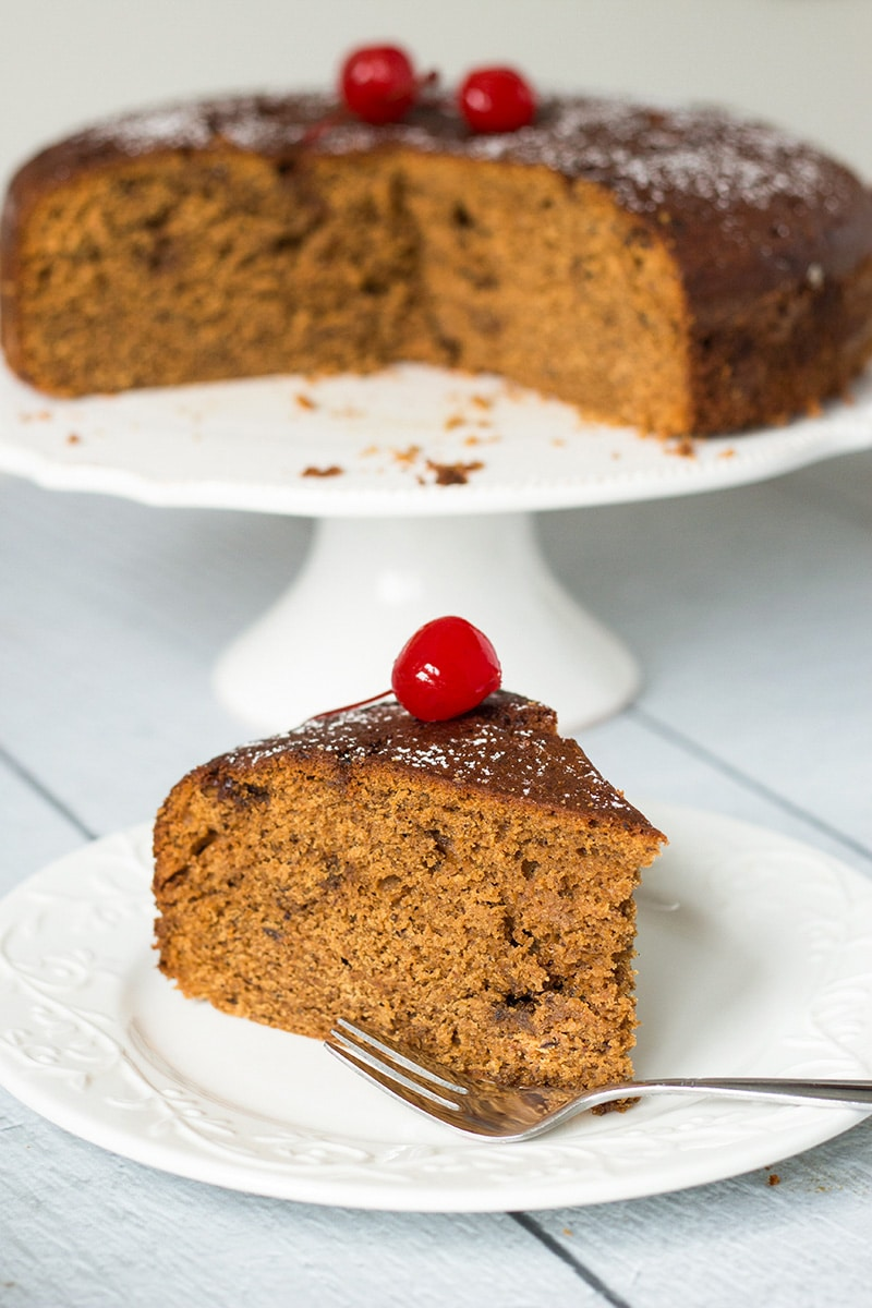 This Jamaican Rum Cake is dark, dense, and filled with rum-soaked dried fruit and Christmassy spices! | cookingtheglobe.com