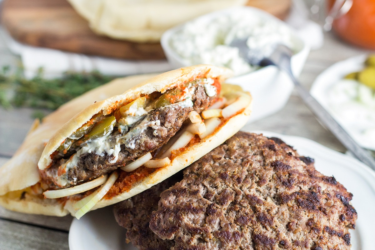 This Serbian burger, called Pljeskavica, will make you forget about all those other burgers from fast food chain places from the very first bite! | cookingtheglobe.com