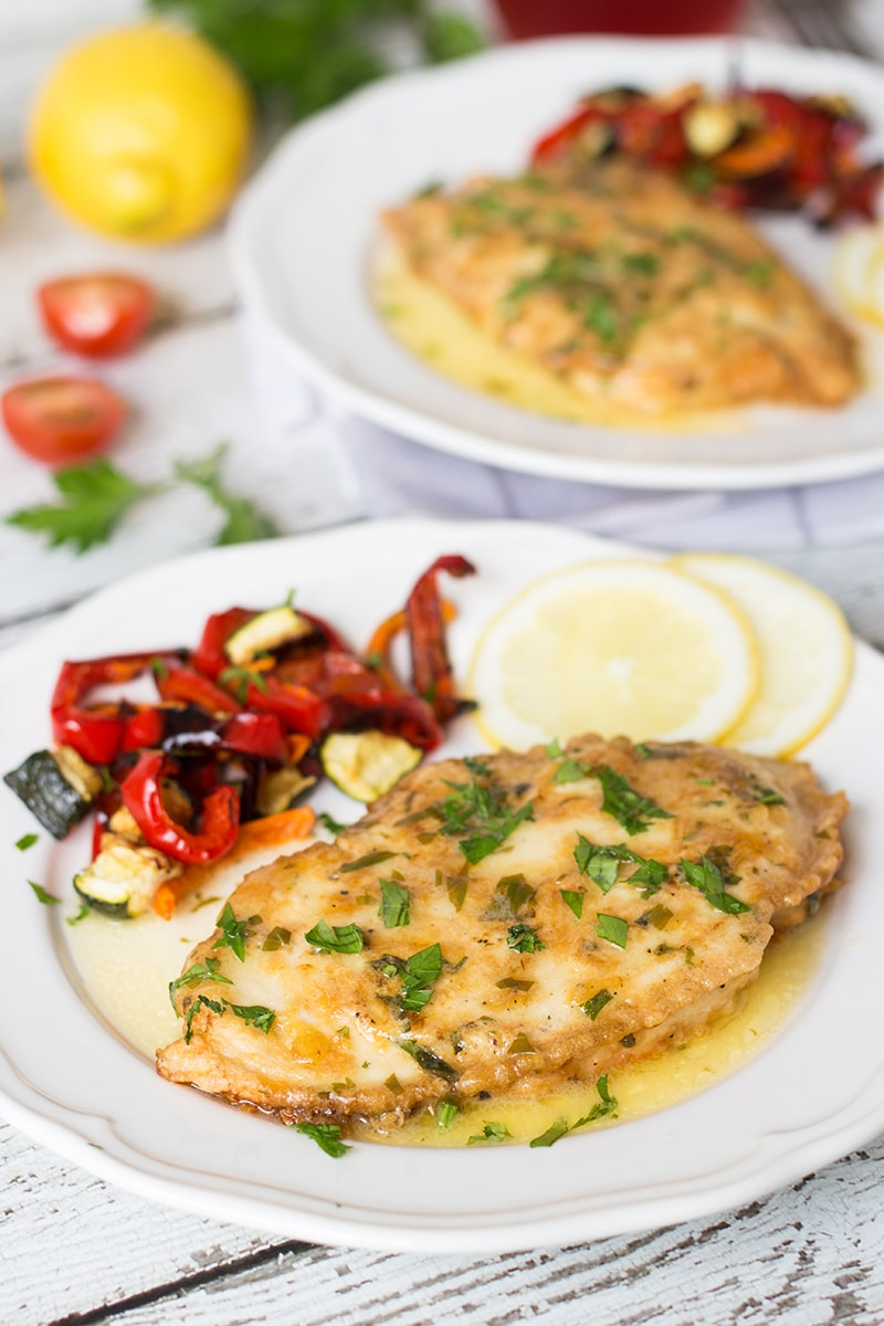 Chicken Francaise is an Italian-American dish consisting of cooked chicken breast cutlets with lemon wine sauce! | cookingtheglobe.com