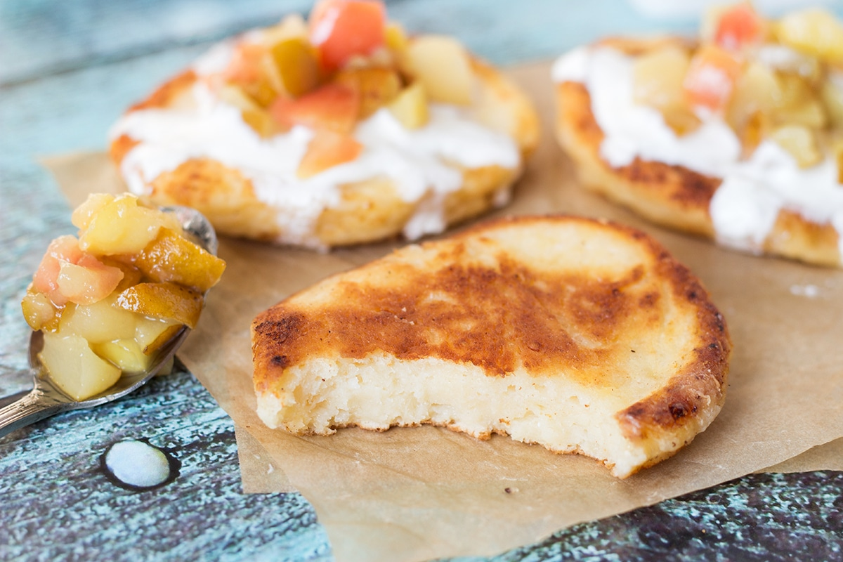 These Cottage Cheese Pancakes come from Russia and are called Syrniki. Served with sour cream and caramelized fruit!   cookingtheglobe.com