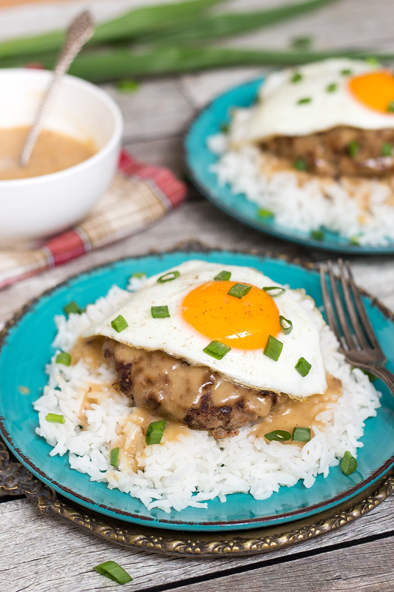 Loco Moco is a popular Hawaiian dish consisting of rice topped with a hamburger patty, fried egg, and drown in a delicious brown gravy!