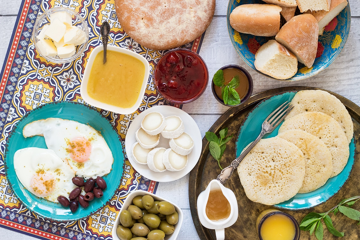 A look at the traditional Moroccan breakfast which features bread, semolina pancakes, fried eggs and the famous mint tea! | cookingtheglobe.com