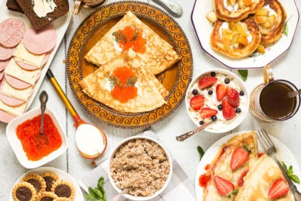 A look at the traditional Russian breakfast featuring two types of pancakes, porridge (kasha), sandwiches (buterbrody) and tea with cookies! | cookingtheglobe.com