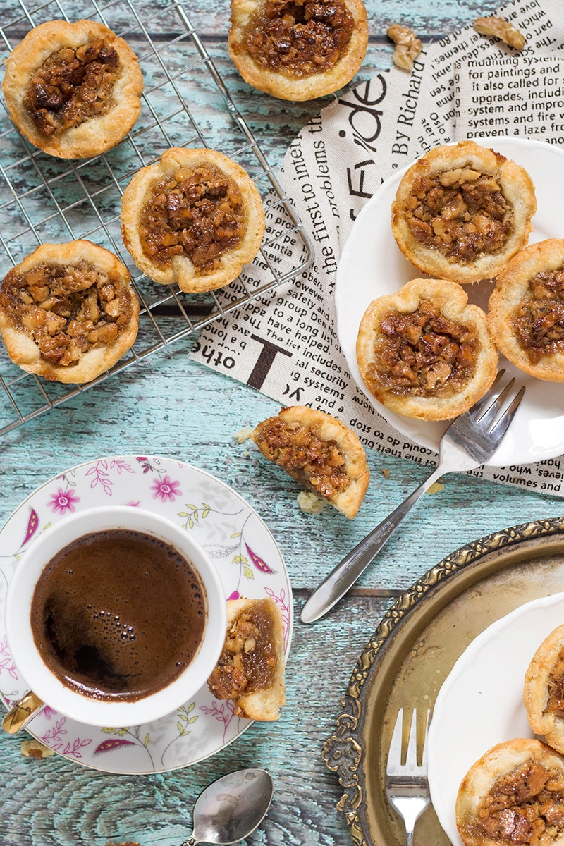 Butter Tarts are the traditional Canadian dessert. These little cute treats are sweet and buttery. One of the best desserts I have ever tried! | cookingtheglobe.com