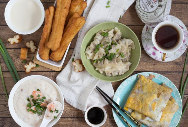 A look at the traditional Chinese breakfast including dumplings, rice porridge, fried bread sticks, and amazing crepes! | cookingtheglobe.com