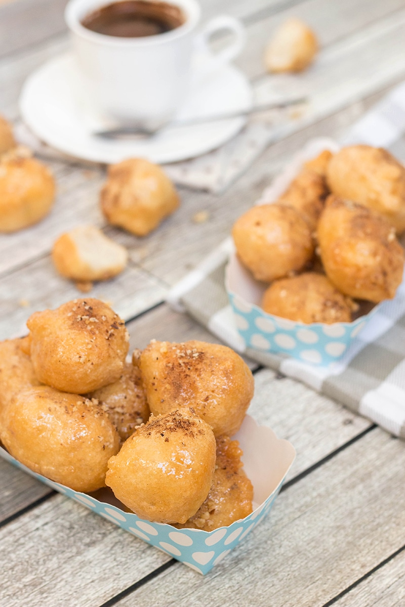 Check out these traditional Greek honey puffs (Loukoumades) sprinkled with cinnamon and walnuts. They are also called Greek donuts. Heaven for your taste buds!
