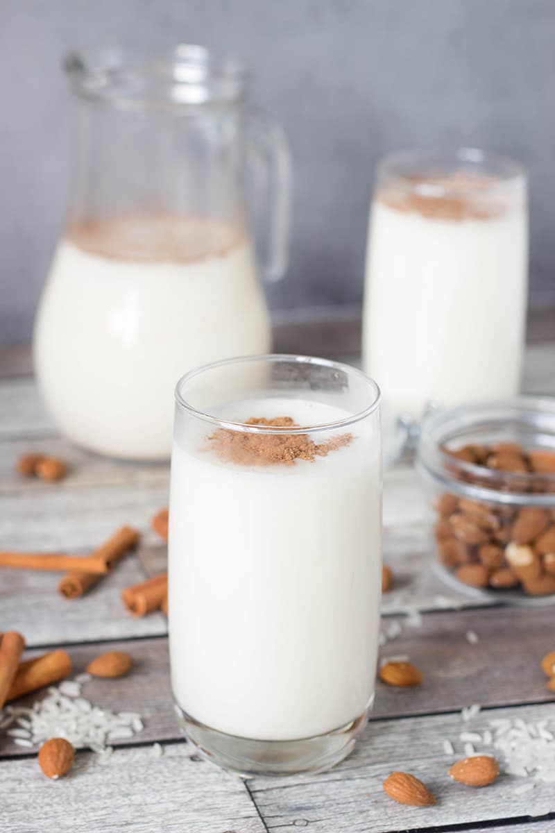 This authentic Horchata recipe has everything you need: rice, almonds, cinnamon, and lime zest mixed together to create a creamy, refreshing, thirst-quenching Mexican drink! | cookingtheglobe.com