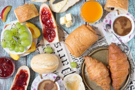 A look at the famous French breakfast, featuring a selection of breads and toppings, croissants, Pain au chocolat, and other goodies! | cookingtheglobe.com