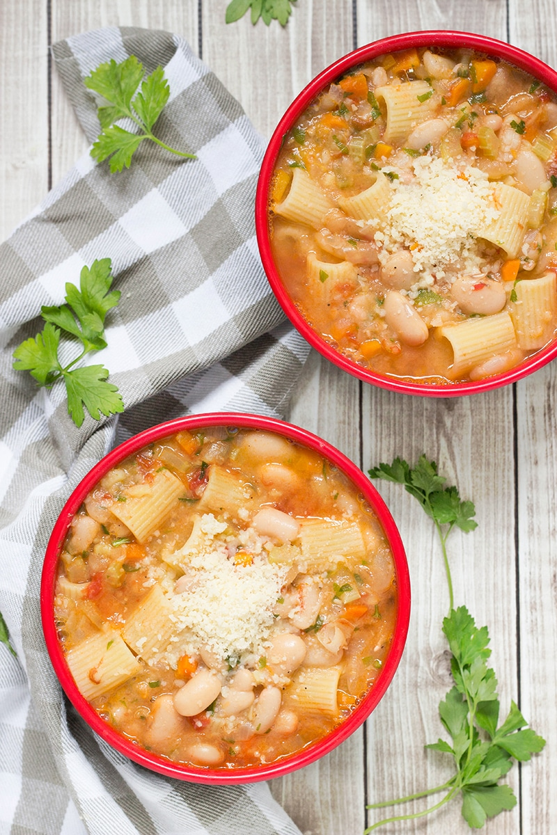 Pasta Fazool, also known by the name Pasta e Fagioli, is a classic Italian pasta and bean soup. It also features Parmesan cheese, tomatoes, and tons of other veggies!   cookingtheglobe.com