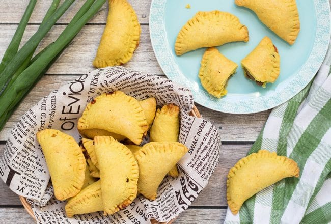 These flaky Jamaican Beef Patties are filled with a spicy ground beef mixture flavored with onion, thyme, pepper, and curry. Perfect on-the-go snack any time of the day! | cookingtheglobe.com