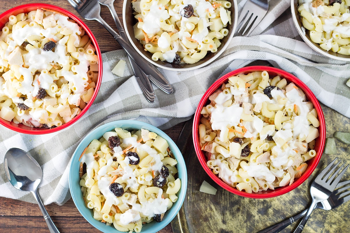 This Filipino Macaroni Salad is not the one you are used to. It features pineapple, raisins, and condensed milk. Mildly sweet, creamy, comforting - you'll love it!   cookingtheglobe.com