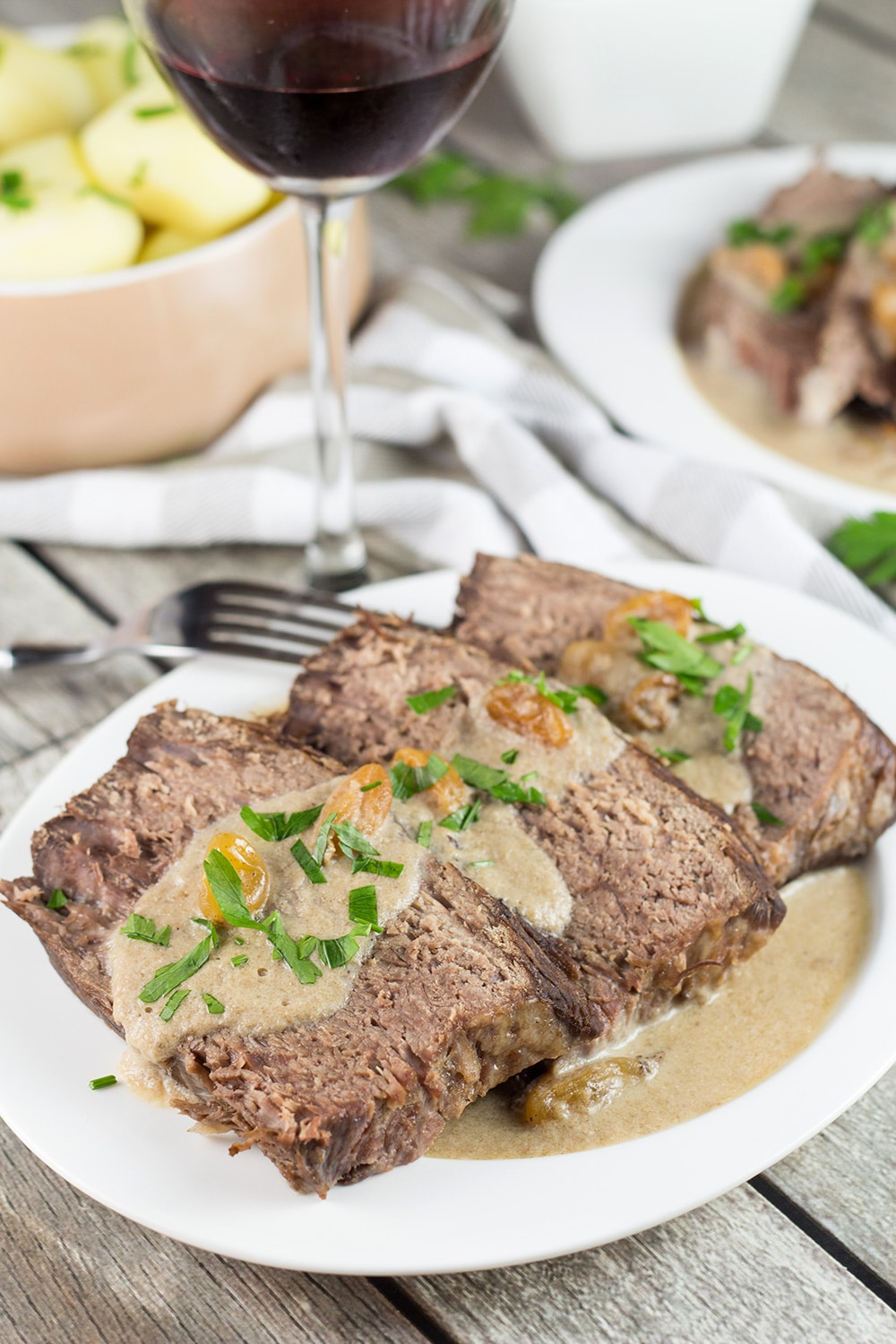 Sauerbraten is a signature German dish often served on Christmas. It's the fork-tender pot roast drowned in a fantastic sweet & sour gravy!   cookingtheglobe.com