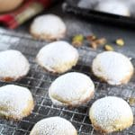 These Greek Butter Cookies (Kourabiedes) are usually made on Christmas or other holidays. They are tender, buttery, and stuffed with pistachios! | cookingtheglobe.com