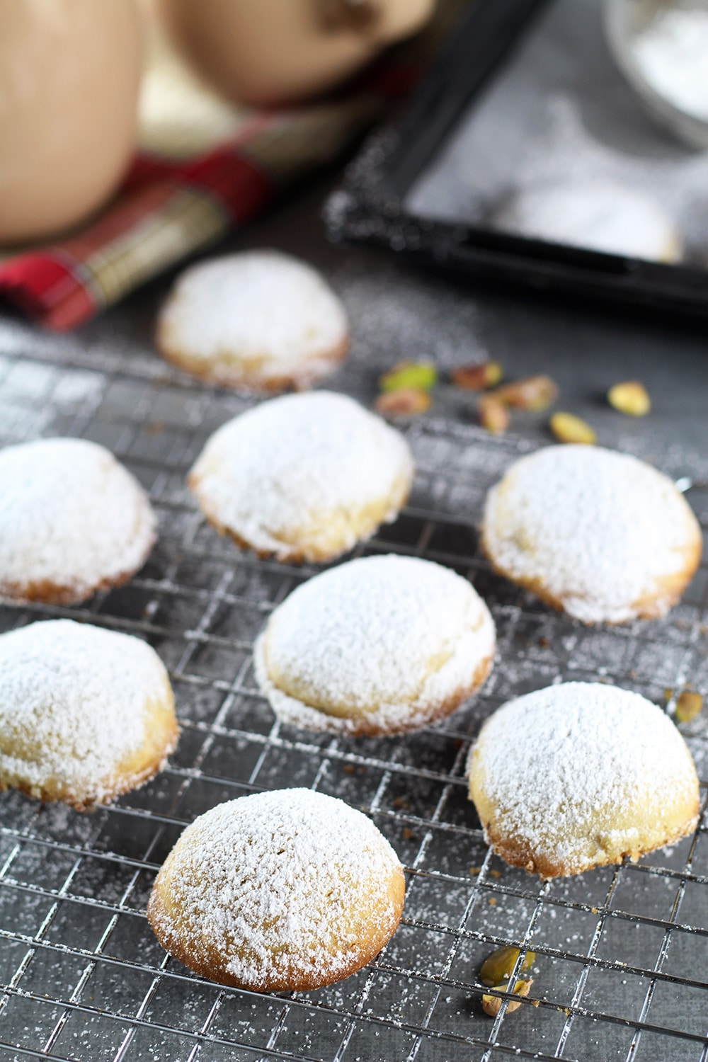 These Greek Butter Cookies (Kourabiedes) are usually made on Christmas or other holidays. They are tender, buttery, and stuffed with pistachios!   cookingtheglobe.com