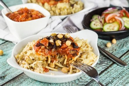 Koshari, or lentils and rice, is a national Egyptian dish. It also features pasta, chickpeas, fried onions, and a homemade tomato sauce. Healthy, filling, nutritious! #vegetarian #vegan| cookingtheglobe.com
