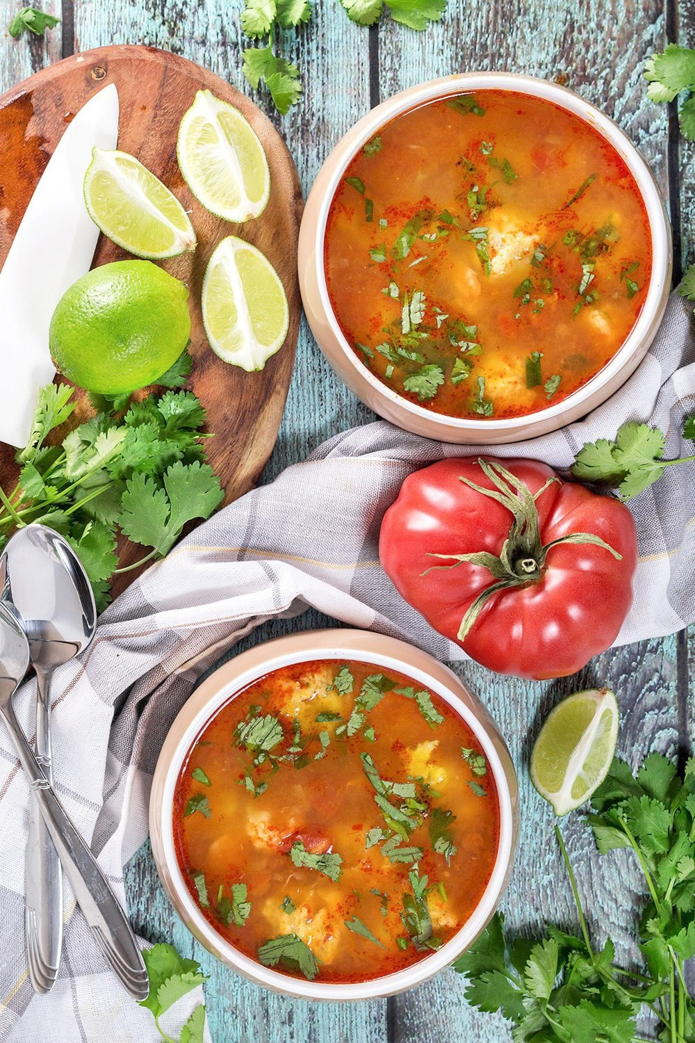 This amazing Mexican Shrimp Soup features super tender shrimp meatballs swimming in a flavorful spicy tomato broth. So easy and quick to make!   cookingtheglobe.com