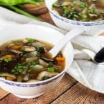This Japanese Clear Soup uses a flavorful dashi stock as a base and also features shiitake mushrooms and a bunch of veggies! A perfect appetizer or a light lunch!   cookingtheglobe.com