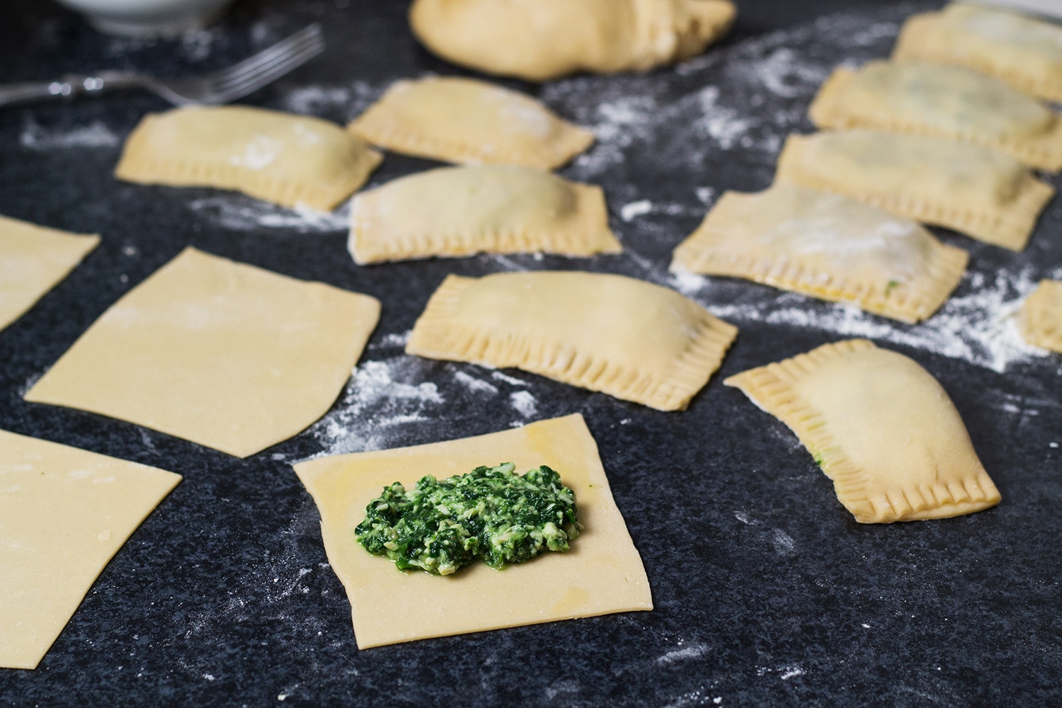 Maultaschen is a German version of Italian ravioli dumplings, only way bigger. This recipe features two different fillings: a traditional and a modern one! | cookingtheglobe.com