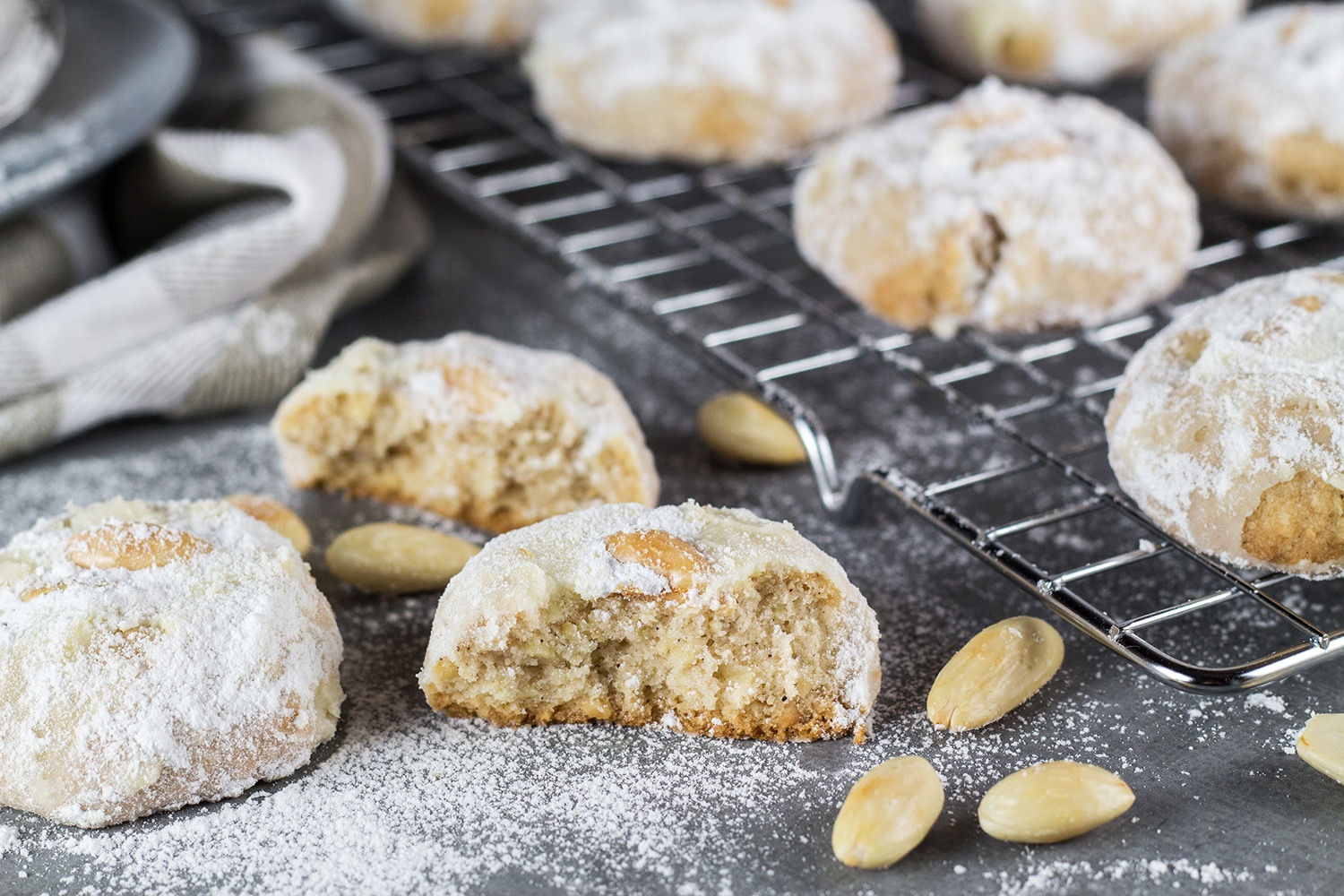 These Mexican Wedding Cookies are buttery, crumbly, nutty, and topped with whole almonds. Perfect with a mug of hot cocoa or a cup of milk, tea, or coffee! | cookingtheglobe.com