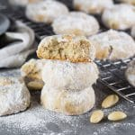 These Mexican Wedding Cookies are buttery, crumbly, nutty, and topped with whole almonds. Perfect with a mug of hot cocoa or a cup of milk, tea, or coffee!   cookingtheglobe.com