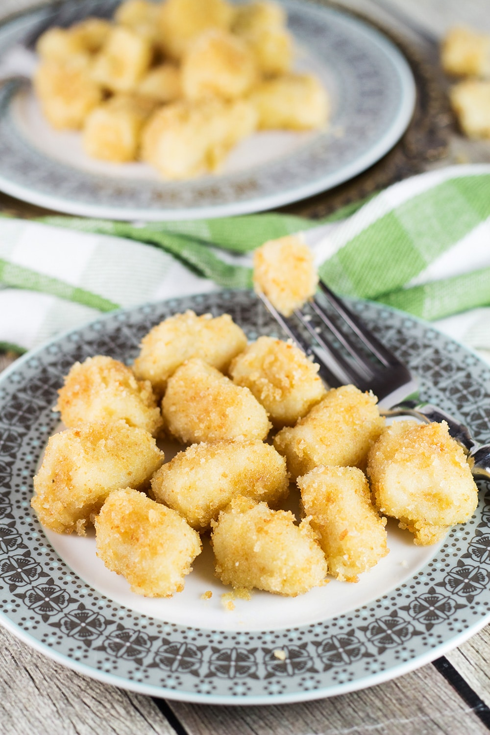 Shlishkes, or Hungarian Potato Dumplings, is a perfect side dish for everyone. These little guys are made with mashed potatoes and covered in buttered bread crumbs!   cookingtheglobe.com