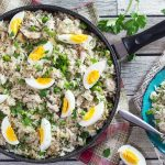 Kedgeree is a traditional British dish usually eaten for breakfast. Smoked fish, spiced rice, peas, onions, and hard-boiled eggs. A true flavor bomb! | cookingtheglobe.com
