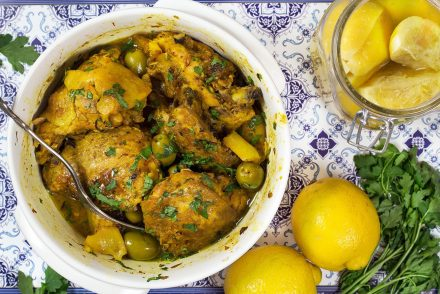 This Moroccan Chicken Tagine is bursting with flavor! Infused with saffron and flavored with preserved lemons, it's guaranteed to become your favorite!   cookingtheglobe.com