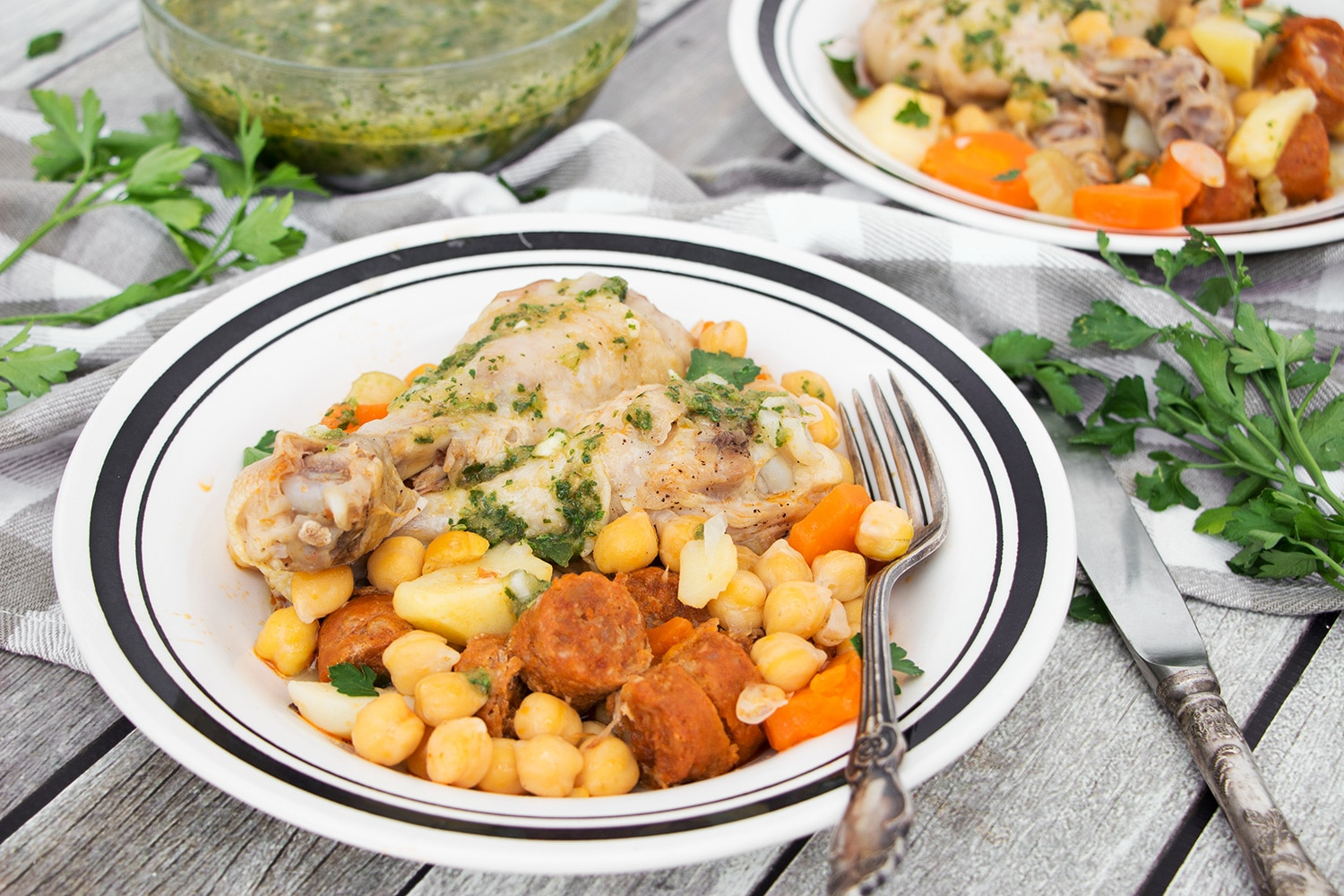 Cocido is one of the most iconic Spanish dishes. While this stew can be made numerous ways, my version features chicken, chorizo, chickpeas, and a bunch of veggies! | cookingtheglobe.com