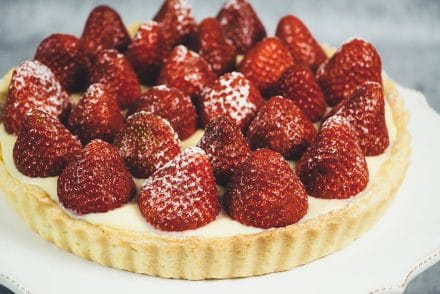 This French Strawberry Tart is literally the best thing you can make with fresh full-of-flavor strawberries. A buttery tart shell + custard + strawberries! | cookingtheglobe.com