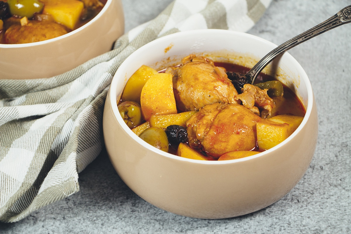 Fricase De Pollo is the famous Cuban chicken stew packed with tons of different flavors. A great stew the whole family will love!   cookingtheglobe.com