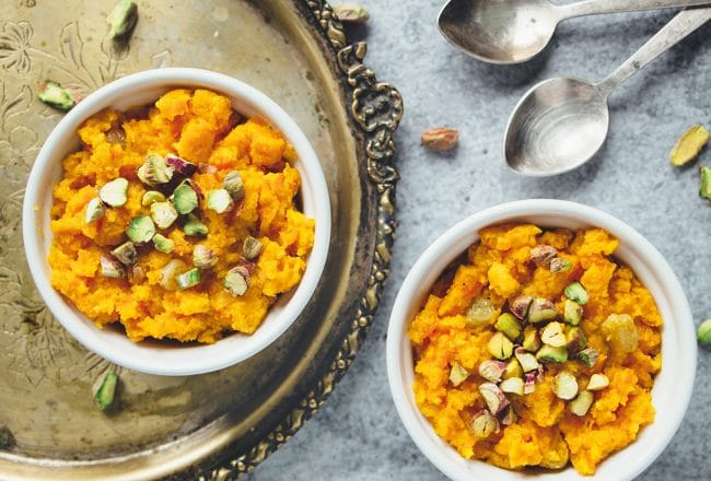 Gajar Ka Halwa is a well known Indian carrot dessert consisting of grated carrots, ghee, milk, sugar, and nuts. Infused with cardamom, it's truly amazing! | cookingtheglobe.com