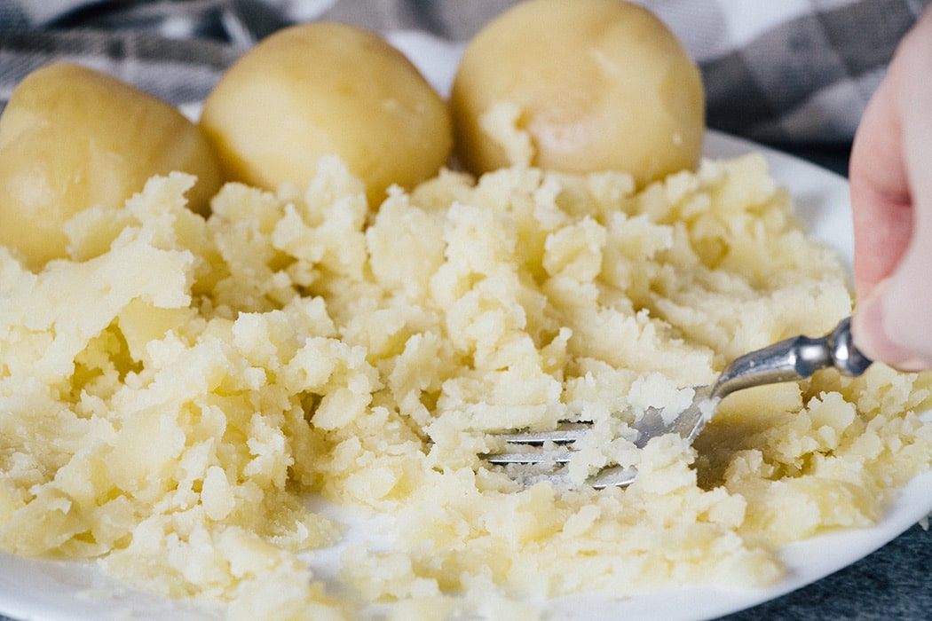 Mashing potatoes with a fork