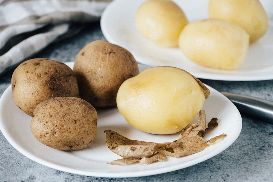 Peeling boiled potatoes