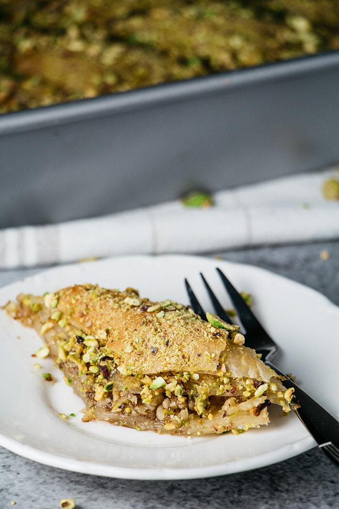 A Turkish baklava slice sprinkled with pistachios