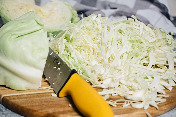 Thinly slicing fresh cabbage