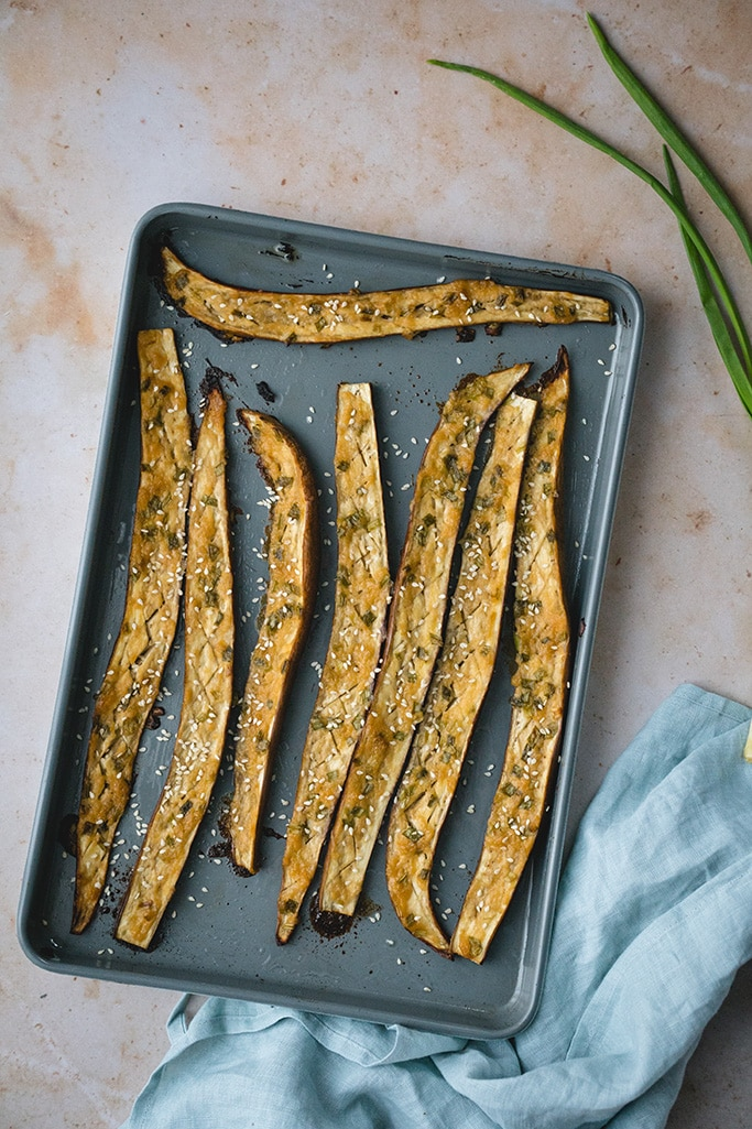 Miso roasted Japanese eggplant topped with white sesame seeds overhead shot
