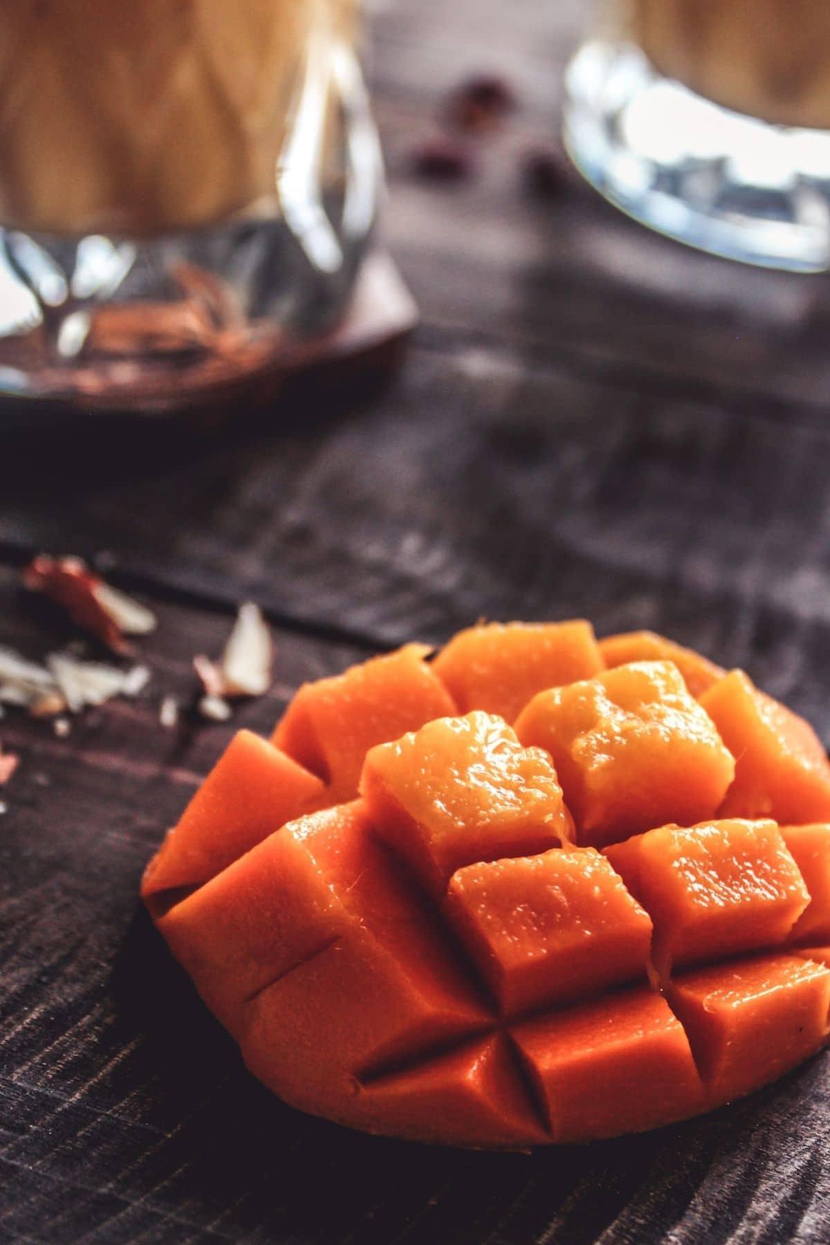 Mango half sliced on table